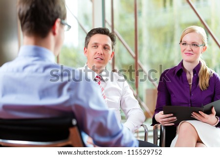 Man having an interview with manager and partner employment job candidate hiring resume CEO work business - stock photo