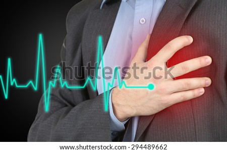 Man having chest pain - heart attack - stock photo