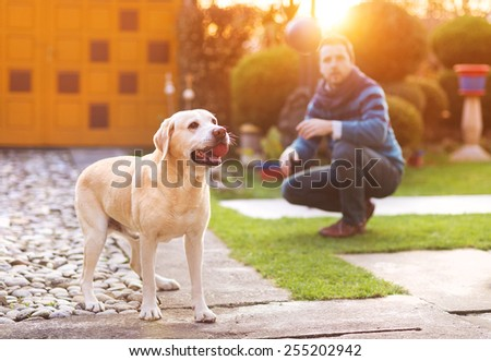 Man having fun and playing with his dog