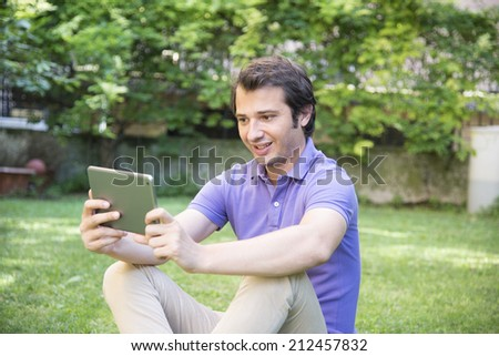 man having fun and relax with tablet internet - stock photo