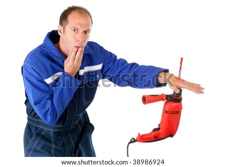 man having hand pierced by drill isolated on white background - stock photo