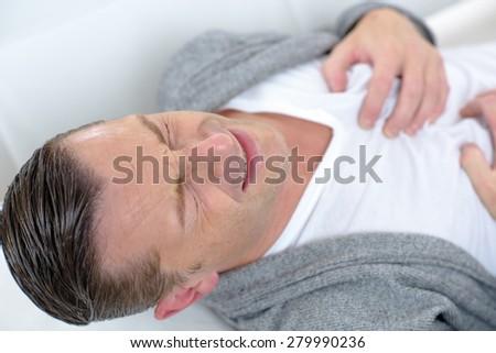 Man having heart pain - stock photo