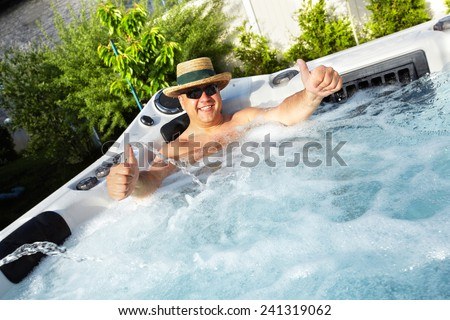 Man having massage in  hot tub Jacuzzi. Spa background. - stock photo