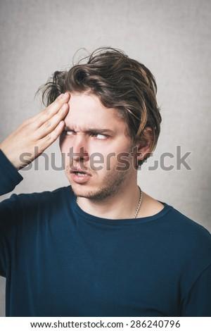 Man headache. Gray background - stock photo