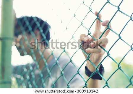 Man held cage - stock photo