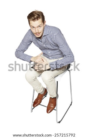 Man hides tablet, does not want to show what's on it. - stock photo