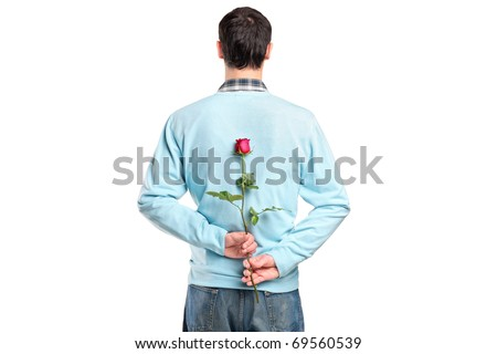 Man hiding a flower behind his back isolated on white background - stock photo