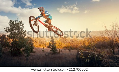 Man high jump on a mountain bike. Downhill cycling.  - stock photo
