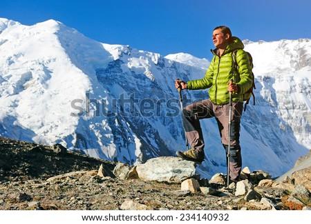 Man hiker trekking exploring in high Himalaya Mountains in Nepa - stock photo