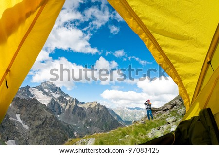man hiking in a mountain - stock photo