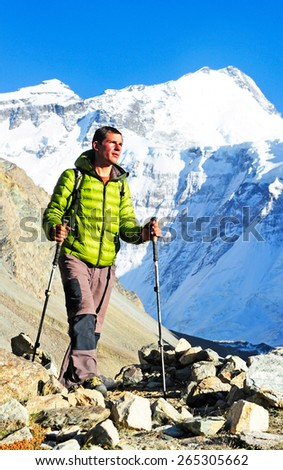 man hiking in a mountains - stock photo