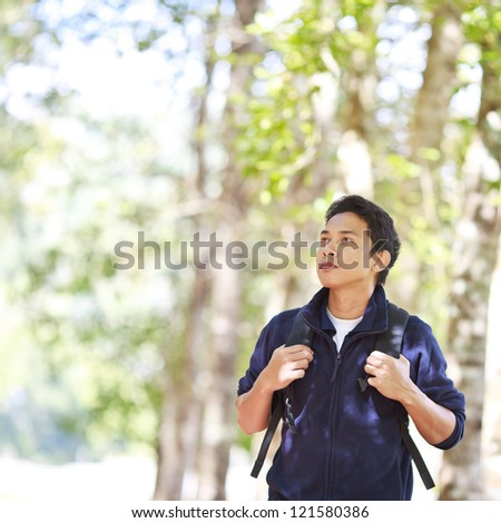 Man hiking in forest - stock photo