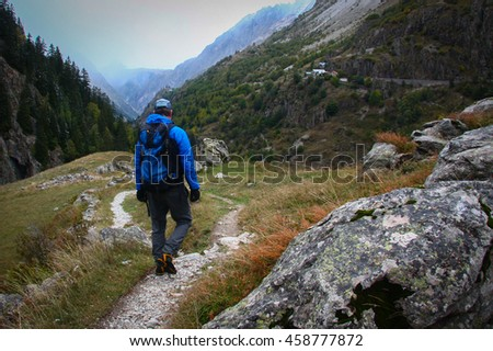 Man hiking in the French alps in the cool, crisp days of Autumn