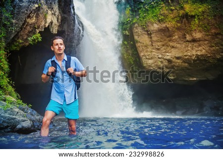 man hiking through the river in Bali, Indonesia - stock photo