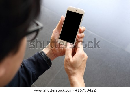Man hloding and using smartphone