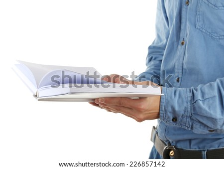 Man hold book isolated on white - stock photo