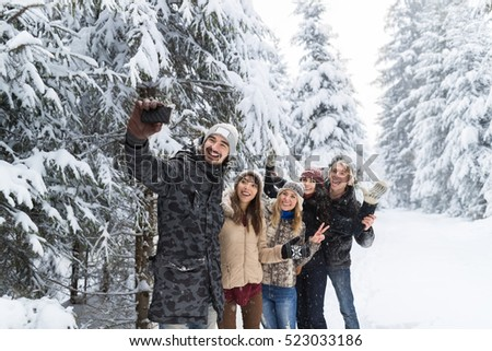 Man Hold Smart Phone Camera Taking Selfie Photo Friends Smile Snow Forest Young People Group Outdoor Winter Pine Woods