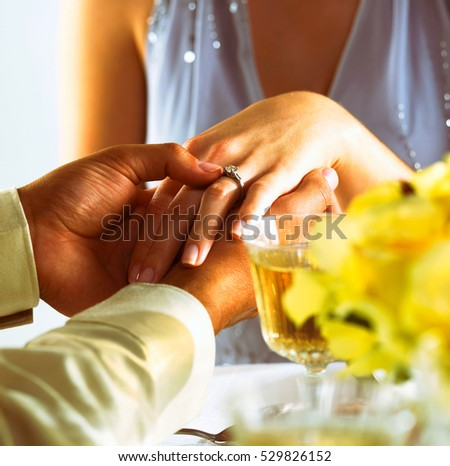 man hold woman hand at cafe, wedding ring