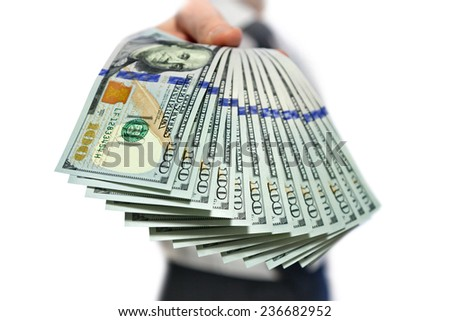man holding a a stack of money in hand - stock photo