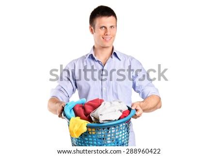 Man holding a basket full of laundry isolated on white background - stock photo