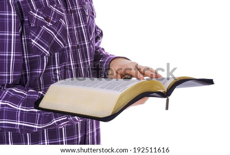 Man holding a Bible, isolated on white background  - stock photo