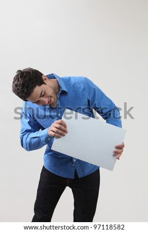 Man holding a blank paper