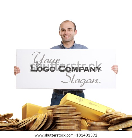 Man holding a blank sign standing on a pile of gold - stock photo