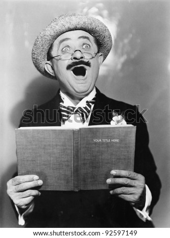 Man holding a book and singing - stock photo