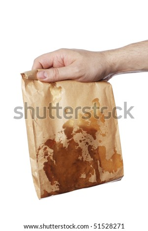 Man holding a brown paper bag with very greasy contents - stock photo