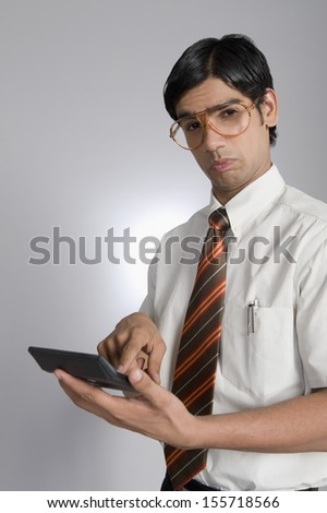 Man holding a calculator - stock photo