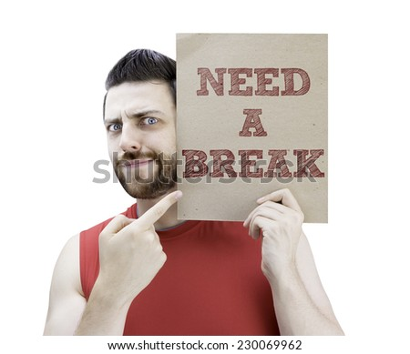 Man holding a card with the text Need a Break on white background - stock photo