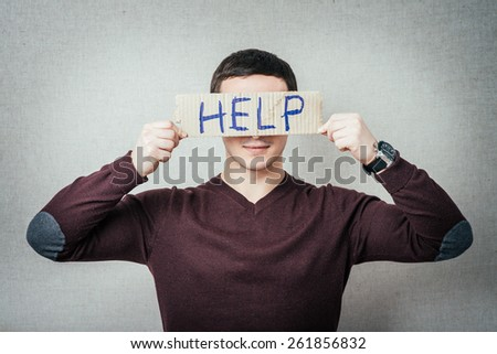 man holding a cardboard with the inscription help - stock photo