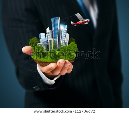 Man holding a city  in hand - stock photo