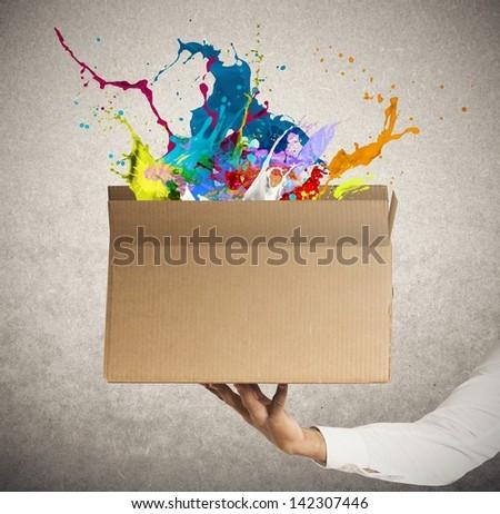 Man holding a creative business box - stock photo