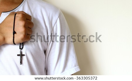 Man holding a cross for pray - stock photo