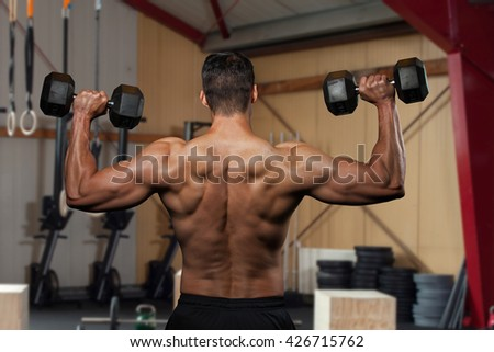 Man holding a dumbbell doing a fitness workout