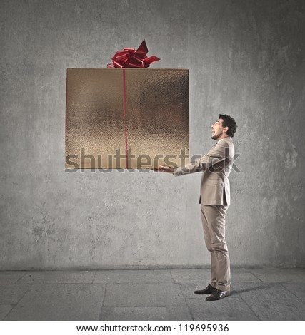 Man holding a giant present - stock photo