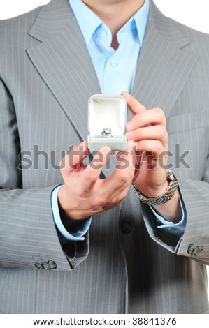 Man holding a gift box with jewelry - stock photo