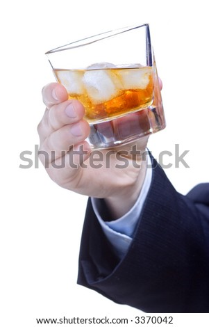 Man holding  a glass of whiskey against white background - stock photo