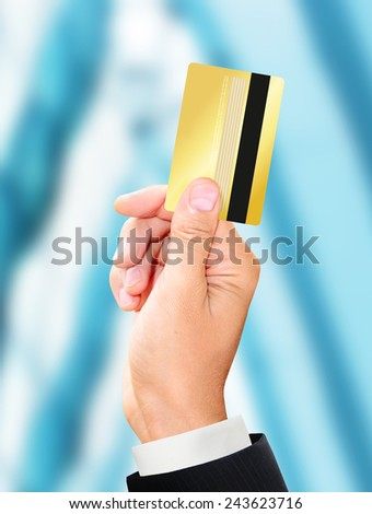 man holding a gold card - stock photo