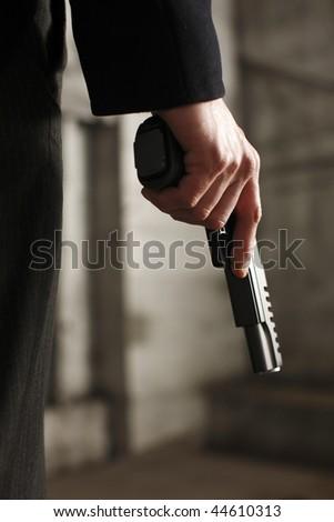 Man holding a gun. - stock photo