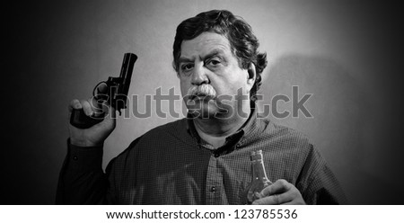 man holding a gun and a bottle of whiskey