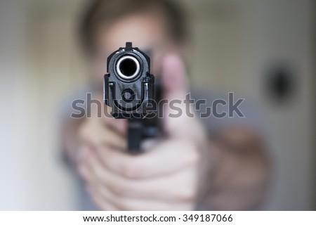 Man holding a handgun in self defense - stock photo