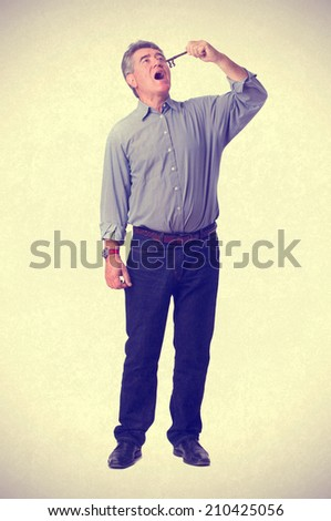 Man holding a key - stock photo