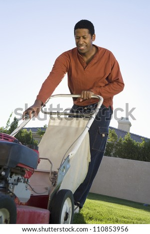 Man Holding A Lawn Mower - stock photo