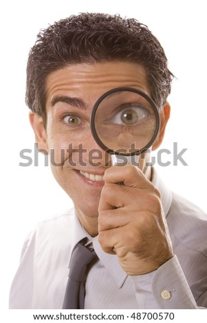 Man holding a magnifier over his eye