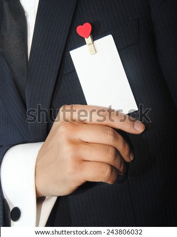 man holding a namecard with heart - stock photo