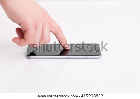 man holding a phone with isolated screen over the desk in the office
