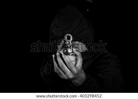 Man holding a pistol  - stock photo