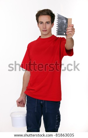 Man holding a scraping tool